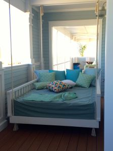 The perfect spot for a nap. Hanging bed on deck by master bedroom in Coastal Living Showhouse in Port Aransas.
